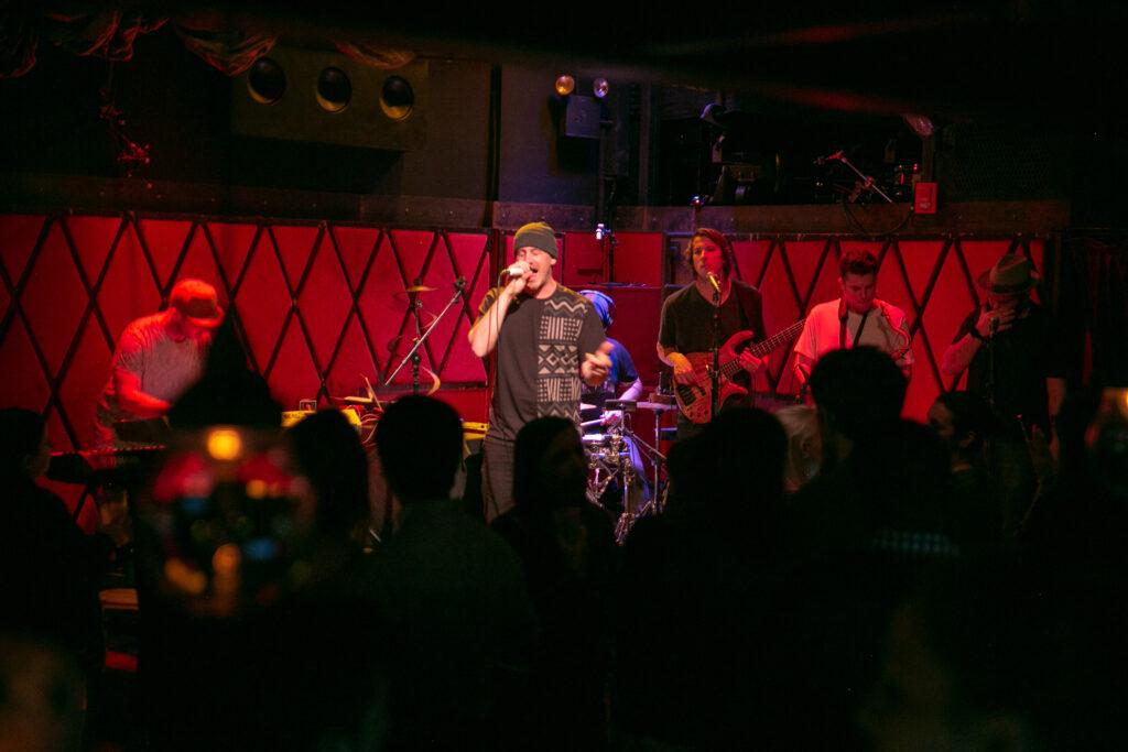 rapper-on-stage-rockwood-music-hall-performance-band-hip-hop